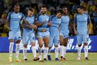 Soccer Football - Borussia Dortmund v Manchester City - International Champions Cup - Longgang Stadium, Shenzhen, China - 28/7/16 Manchester City's Sergio Aguero (C) celebrates with team mates at the end of the match after winning the penalty shootout Action Images via Reuters / Bobby Yip Livepic EDITORIAL USE ONLY.